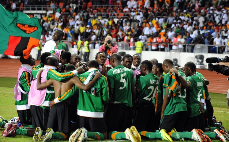 Zambia national team prays together after their victory over Ivory Coast at the Africa Cup of Nations (CAN) final football between the two teams at stade de l'Amitie in Libreville, Gabon on February 12, 2012. AFP PHOTO/ PIUS UTOMI EKPEI (Photo credit should read PIUS UTOMI EKPEI/AFP/Getty Images)